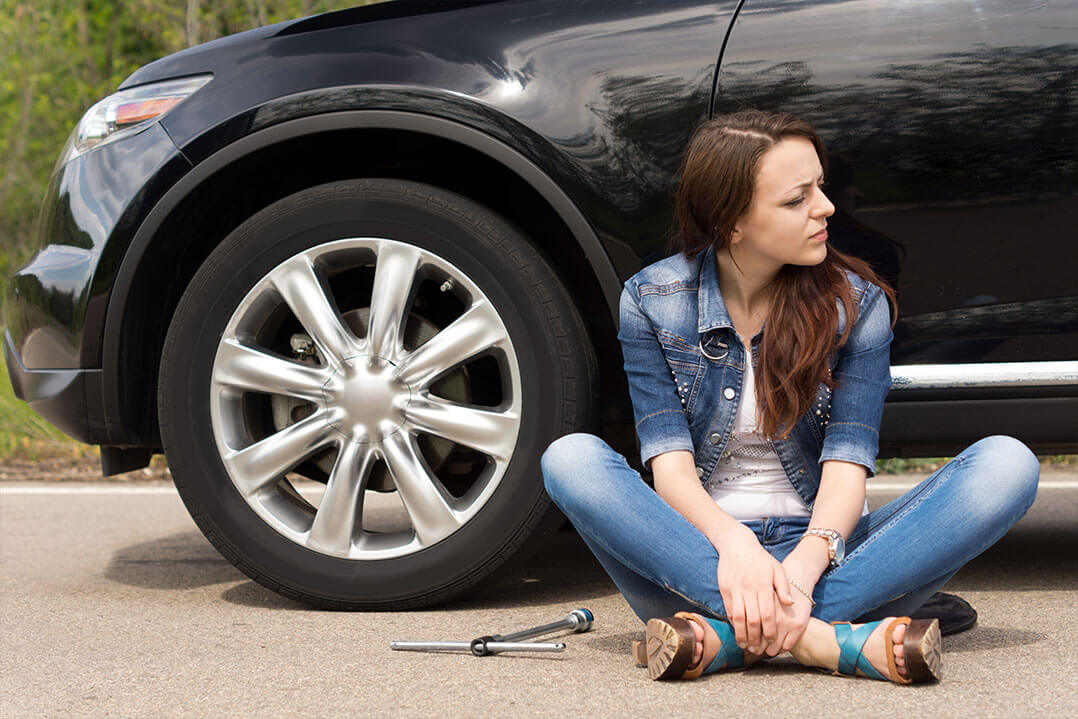 Lady Changing Tire